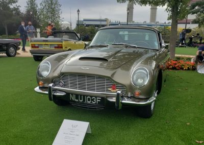 This is a photo of an Aston Martin DB5 displayed at the Boston Cup 2020 Car Show in Everett, MA.